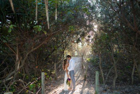 Beach Bride and Groom Kissing walkway