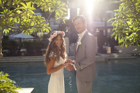 Bridal Couple surrounded by Frangipani and Pool